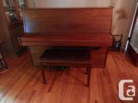 Liebermann modern style upright piano, with bench. Good