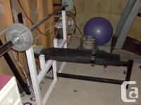 Available for sale is a North Light Olympic Bench/Squat