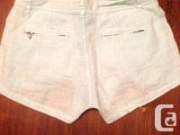 Light blue Guess shorts, size 24, but they fit a little