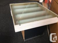 This light table is well built and works well. It has a
