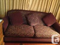Up for sale is a very comfortable fabric couch and 2