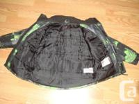 I have a Like New Coat Winter Green Black Size 7-8 for