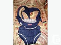 This Evenflo Snugli is navy blue with white plaid