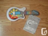 I have a Like New Let's Rock Elmo with Guitar, Drums