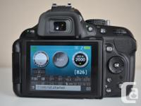 Selling my Nikon D5200 body only with original box,