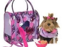 Travels in style with your puppy doll in this trendy