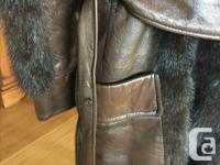 Short jacket in excellent condition. Small leather/fur
