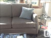 Beautiful designer sofa with nail heads,down wrapped