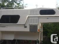 North lite 9 foot camper. Unusual design. Has 4 burner
