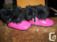 In mint condition,beautiful Robeez boots for baby