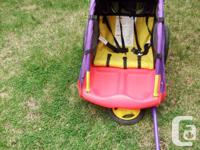 This two seat Little Tykes bike trailer is ready to go.
