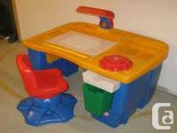 Very cute little tykes art desk with lamp and chair.