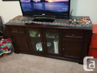 A TELEVISION stand, big ottoman, and 2 side tables.