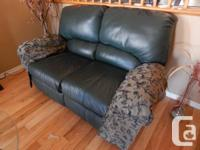 Loveseats and Coffee Table set  - 2 reclining leather