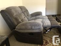 Living room set contains: 2 Recliner Couches - Grey