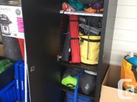 Black locker type storage cabinet. 17 inches wide by 19