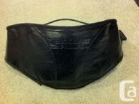 Black leather-textured vinyl tank bra, with a soft