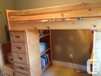 A solid wood loft bed. Purchased at John's Bedroom Barn