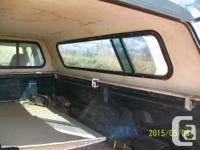 Black fiberglass canopy for a long box truck. Measures