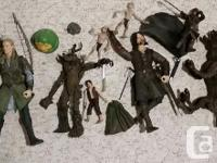 Lord of the Ring Figurines. Good condition. 4 large, 7