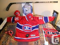 Lot of Montreal Canadiens signed memorabilia.   My dad