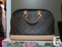 This is a Louis Vuitton Alma Handbag that has never