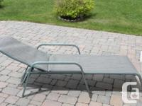 This is an outdoor lounge chair. It is kaki with a