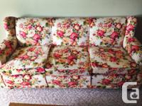 Offering this charming flower couch and chair set since