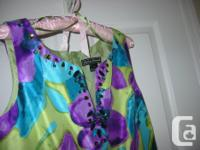 STUNNING COLOURS OF PURPLE, GREEN, BLUE. Click on the