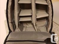Looks and works fantastic with Lowepro quality