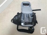 For sale a like new Lowepro SlingShot 100 AW camera