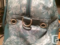 Classic style Lululemon bag in blue lace pattern. Great