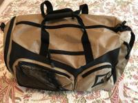 Large Lululemon men's canvas gym bag with backpack