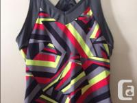 I have two Lululemon tanks for sale and one Saucony