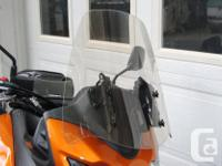 "Hi, Looking for a tall 22"" clear Madstad Windshield for"