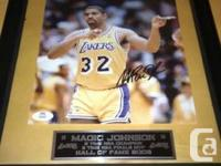 This is an initial autographed image by Earvin Magic