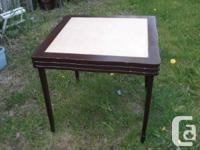 Pic #1 shows a  beautiful foldup mahogany card table
