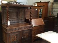Solid and in very good condition. Beautiful wood inlay
