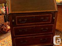 Thanks for your interest in our Mahogany Secretary