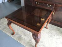 Made from inlaid solid mahogany, this versatile piece
