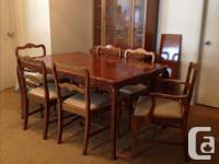 Traditional style, solid maple dining set. Table has 1