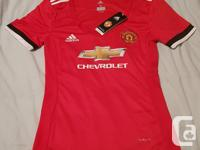 Manchester United women's 2017/18 home red jersey.