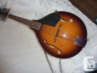 Mandolin (maker: Aspen), with spruce top, laminate side