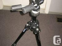 Selling a MANFROTTO Professional mod.055 CB with 3 ways