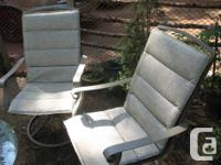 2 grey swivel chairs $60 for both deck with 6 chairs