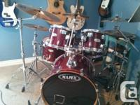 Mapex M drum package with an all-natural red finish.
