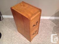 This solid maple wood cupboard has been refinished. The