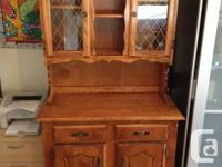 For sale is a matching maple hutch and dining table