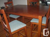 Down-sizing. Pub style Maple Dining Table and 4