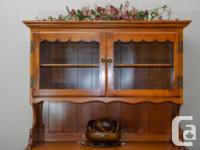 This gorgeous hutch is an ideal enhance to a sideboard